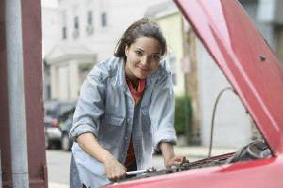 aauto woman fixing car