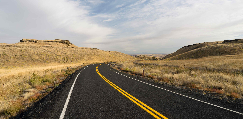 best summer road trips highway view min